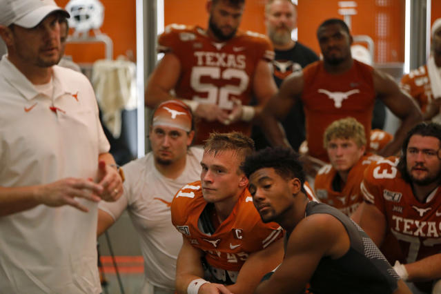 Texas Longhorns quarterback Sam Ehlinger #11 and teammates listen to head coach Tom Herman speak after the game against LSU Saturday Sept. 7, 2019 at Darrell K Royal-Texas Memorial Stadium in Austin, Tx. LSU won 45-38. ( Photo by Edward A. Ornelas )