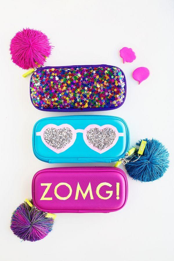 """<p>Trust us: Your daughter will love these glittery, customizable pencil pouches. Chapsticks, colored pencils, ZOMG. </p><p><em><a href=""""https://studiodiy.com/2015/08/18/diy-glittery-graphic-pencil-cases/"""" rel=""""nofollow noopener"""" target=""""_blank"""" data-ylk=""""slk:Get the tutorial at Studio DIY »"""" class=""""link rapid-noclick-resp"""">Get the tutorial at Studio DIY »</a></em></p>"""