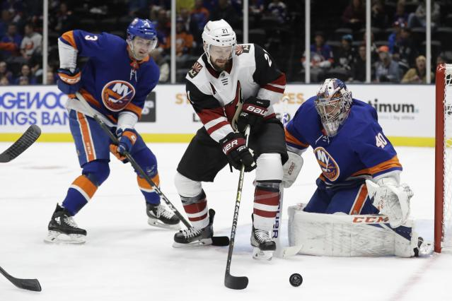 New York Islanders goaltender Semyon Varlamov (40) and teammate Adam Pelech (3) defend against Arizona Coyotes' Derek Stepan (21) during the first period of an NHL hockey game Thursday, Oct. 24, 2019, in Uniondale, N.Y. (AP Photo/Frank Franklin II)