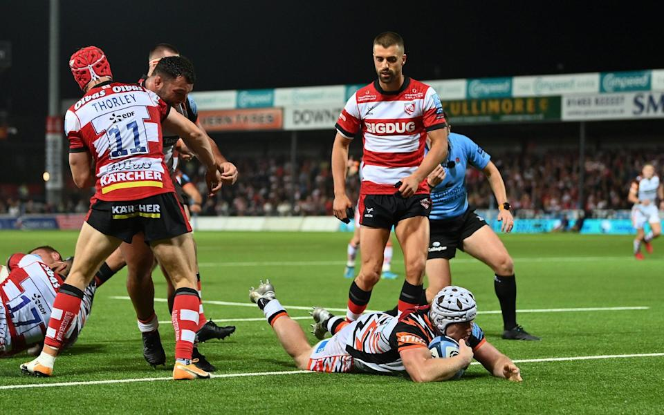Nic Dolly scores the Tigers' fourth try - GETTY IMAGES