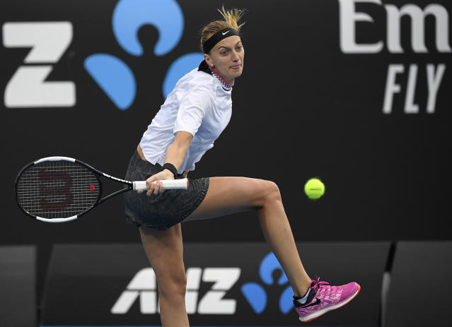 Petra Kvitova of the Czech Republic makes a forehand return to Romania's Irina-Camelia Begu during their second round match at the Australian Open tennis championships in Melbourne, Australia, Wednesday, Jan. 16, 2019. (AP Photo/Andy Brownbill)