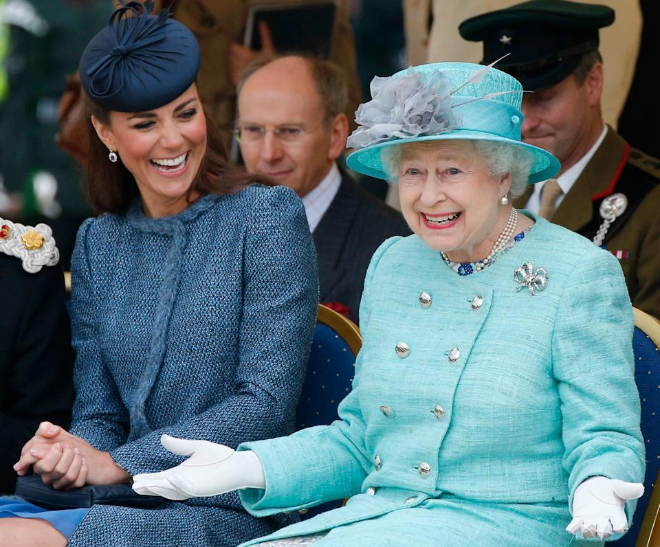 Kate Middleton and Queen Elizabeth II adorn in dark and light blue dresses and hats to match with a lovely smile on their faces