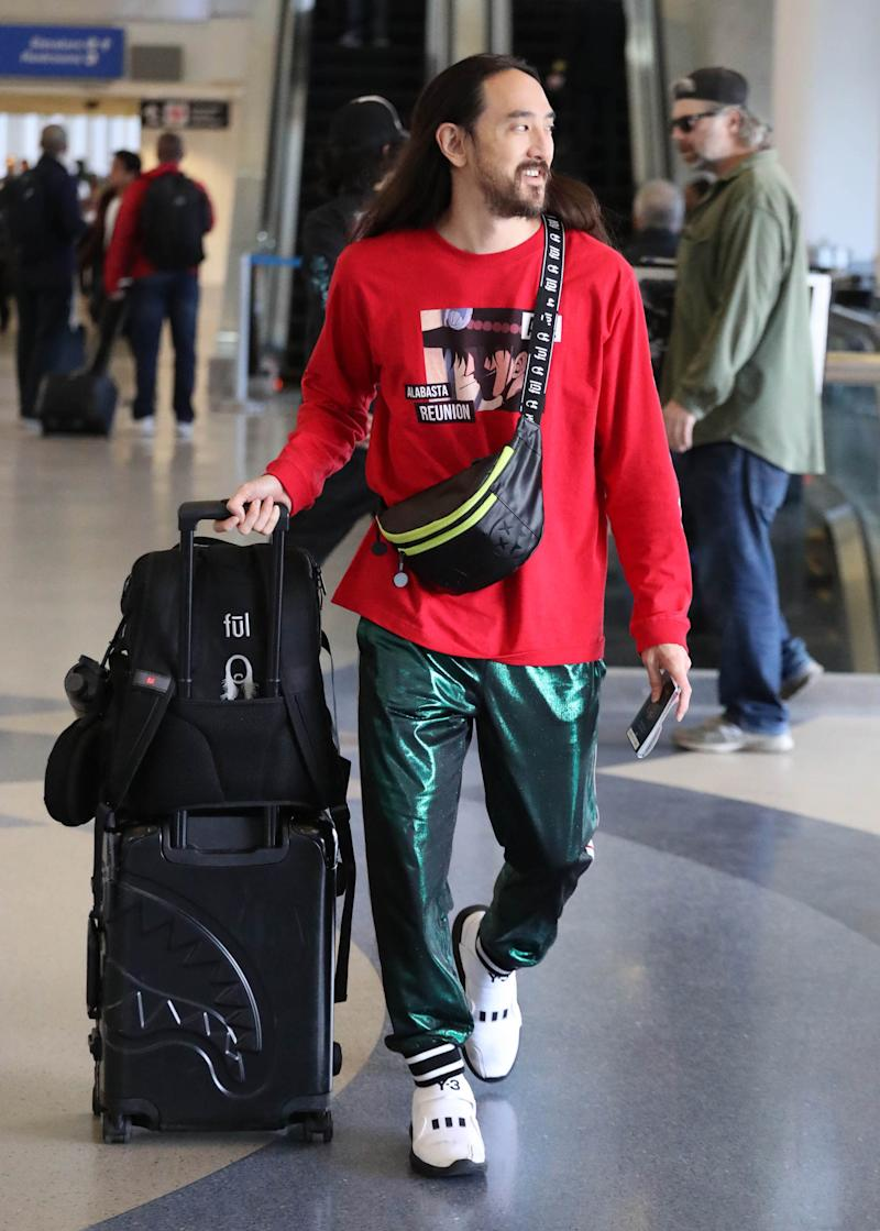 DJ Steve Aoki mid-travel at LAX.