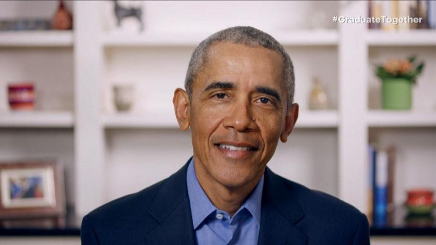 """<div class=""""caption""""> For his second speech of the day, Obama changed from a grey shirt to a blue one and swapped out the basketball resting on his bookshelf for a framed family photo </div> <cite class=""""credit"""">Getty Images </cite>"""