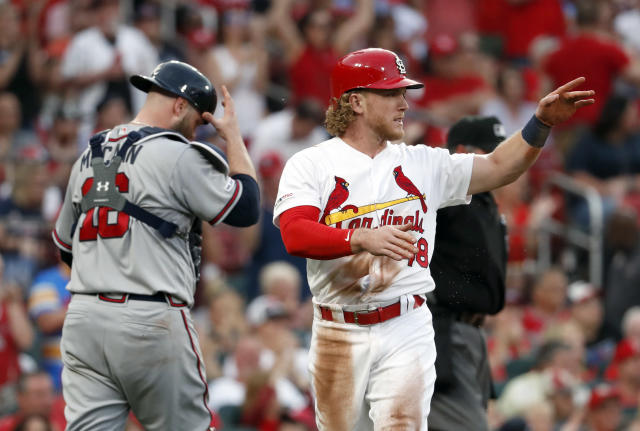 St. Louis Cardinals' Harrison Bader, right, celebrates after scoring as Atlanta Braves catcher Brian McCann walks back to the plate during the fourth inning of a baseball game Sunday, May 26, 2019, in St. Louis. (AP Photo/Jeff Roberson)