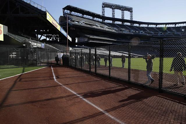 A white chalk line marks the location of the prior season's outfield wall at Citi Field in New York, Tuesday, Nov. 18, 2014. The Mets are moving their fences in at Citi Field for the second time. (AP Photo/Seth Wenig)