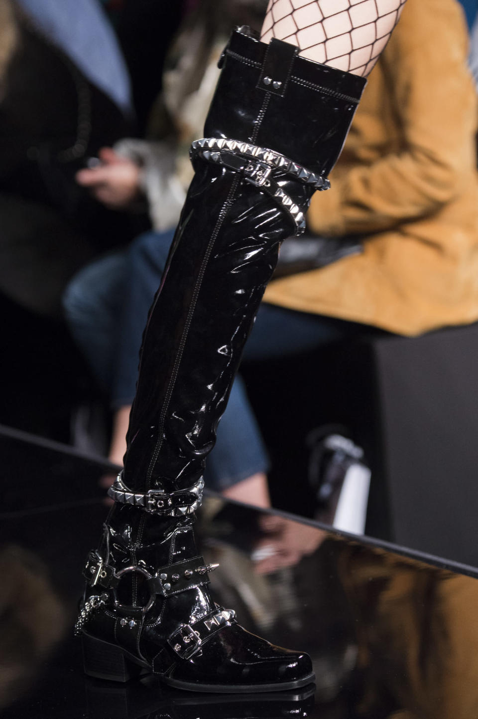 <p><i>Black patent leather studded knee boots from the SS18 Moschino collection. (Photo: ImaxTree) </i></p>