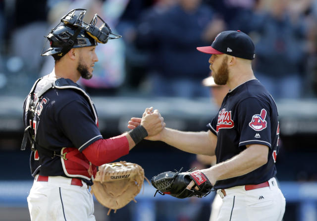 Cleveland Indians relief pitcher Cody Allen, right, is congratulated by catcher Yan Gomes after the Indians defeated the Baltimore Orioles 4-2 in a baseball game, Saturday, Sept. 9, 2017, in Cleveland. (AP Photo/Tony Dejak)