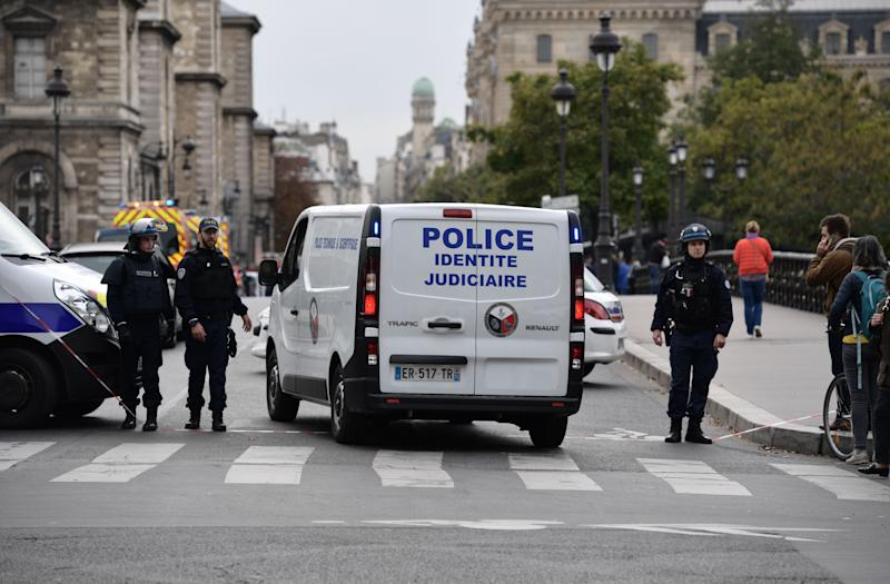 A judicial police vehicle drives toward Paris prefecture de police (police headquarters) after three persons have been hurt in a knife attack on October 3, 2019. - A knife attacker was shot and injured after hurting two people at police headquarters in the historical centre of Paris on October 3, sources told AFP. (Photo by Martin BUREAU / AFP) (Photo by MARTIN BUREAU/AFP via Getty Images)