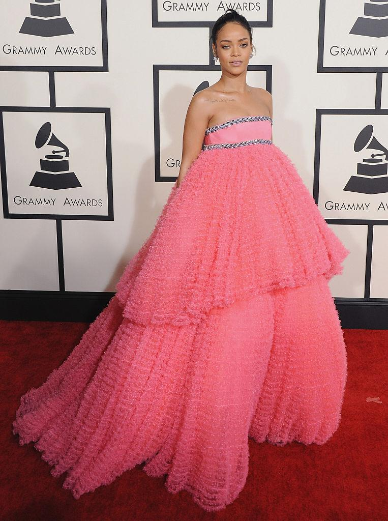 "<p>While the ""Work"" singer has served us countless jaw-dropping red carpet looks over the years, her bright pink Giambattista Valli gown from the 2015 Grammy Awards is most certainly one for the books. (Image via Getty Images)</p>"