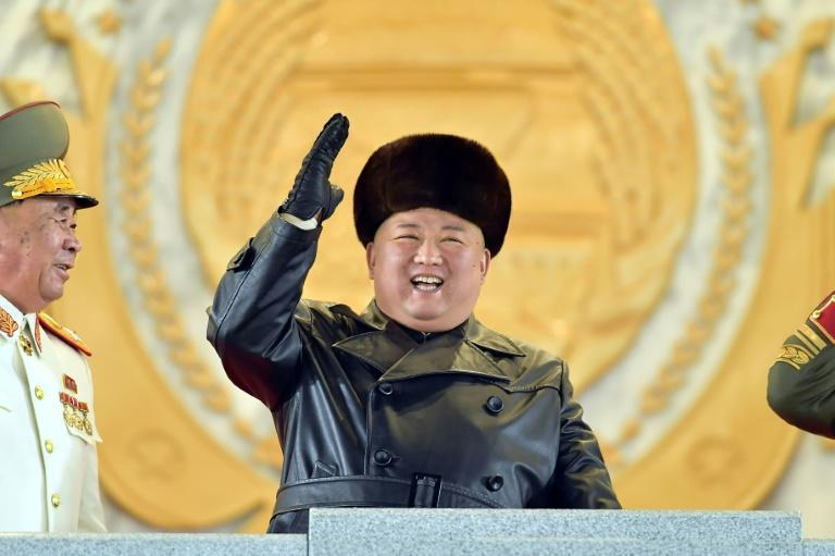 A grinning Kim Jong Un oversaw the parade, wearing a black leather coat and fur hat as he watched infantry troops