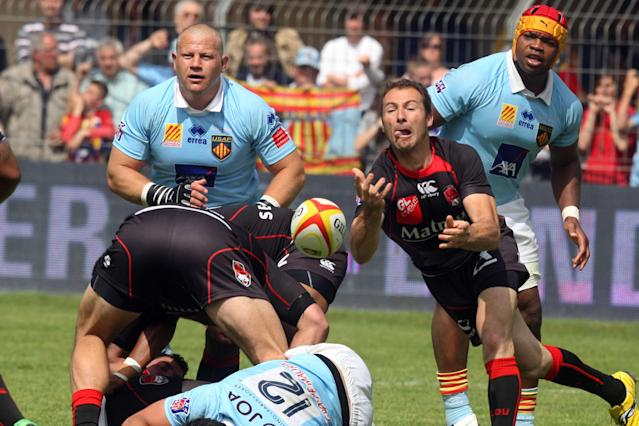 Lyon's French scrum-half Mickael Forest (R) clears the ball out of a scrum during the French Top 14 rugby union match Perpignan vs Lyon, on May 5, 2012 in Perpignan, southern France. Perpignan won 34-22. AFP PHOTO / RAYMOND ROIGRAYMOND ROIG/AFP/GettyImages