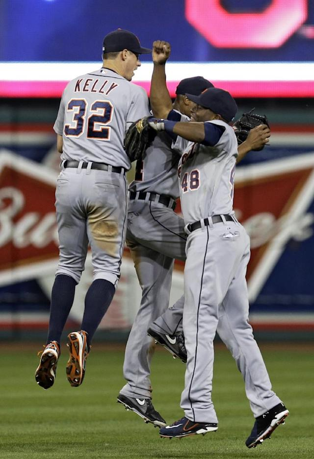 Detroit Tigers outfielders Don Kelly (32), Austin Jackson and Torii Hunter (48) celebrate after a 5-1 win over the Cleveland Indians in a baseball game Tuesday, Aug. 6, 2013, in Cleveland. (AP Photo/Mark Duncan)