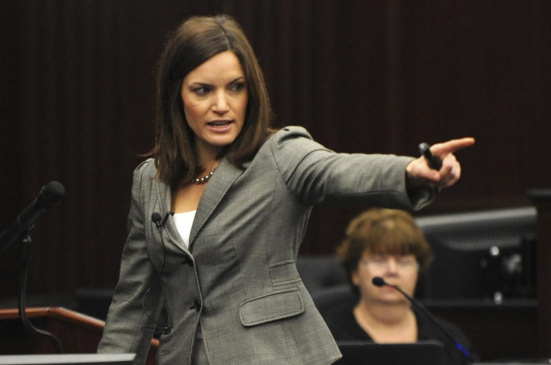 Assistant State Attorney Erin Wolfson points at the defendant Michael Dunn during the State's closing arguments in Dunn's trial, Wednesday, Feb. 12, 2014 in Jacksonville, Fla. Dunn is charged with fatally shooting 17-year-old Jordan Davis after an argument over loud music outside a Jacksonville convenient store in 2012.(AP Photo/The Florida Times-Union, Bob Mack, Pool)