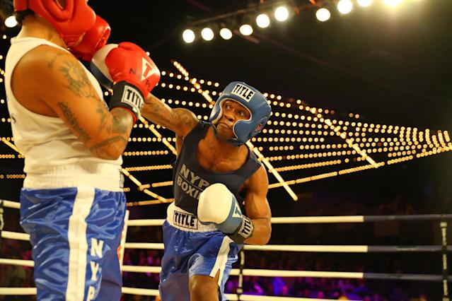 <p>John Chalen (red) battles Reshawn Merrick (blue) in Bronx Precinct Callout during the NYPD Boxing Championships at the Hulu Theater at Madison Square Garden on March 15, 2018. (Gordon Donovan/Yahoo News) </p>