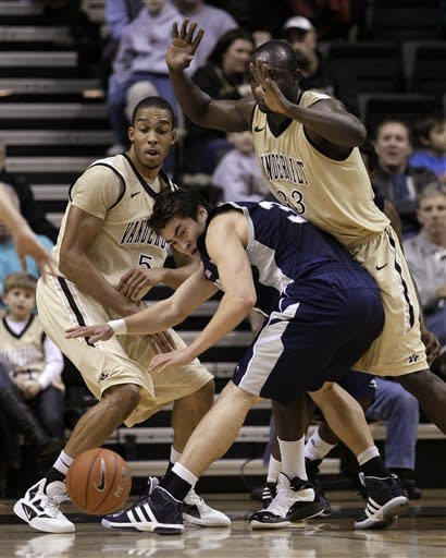 Longwood forward Jan van der Kooij, center, loses the ball as he is defended by Vanderbilt's Lance Goulbourne (5) and Steve Tchiengang, right, in the first half of an NCAA college basketball game on Monday, Dec. 19, 2011, in Nashville, Tenn. (AP Photo/Mark Humphrey)