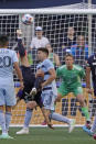 Seattle Sounders forward Fredy Montero goes upside-down as he attempts a bicycle kick shot on goal against Sporting Kansas City during the first half of an MLS soccer match, Sunday, July 25, 2021, in Seattle. (AP Photo/Ted S. Warren)