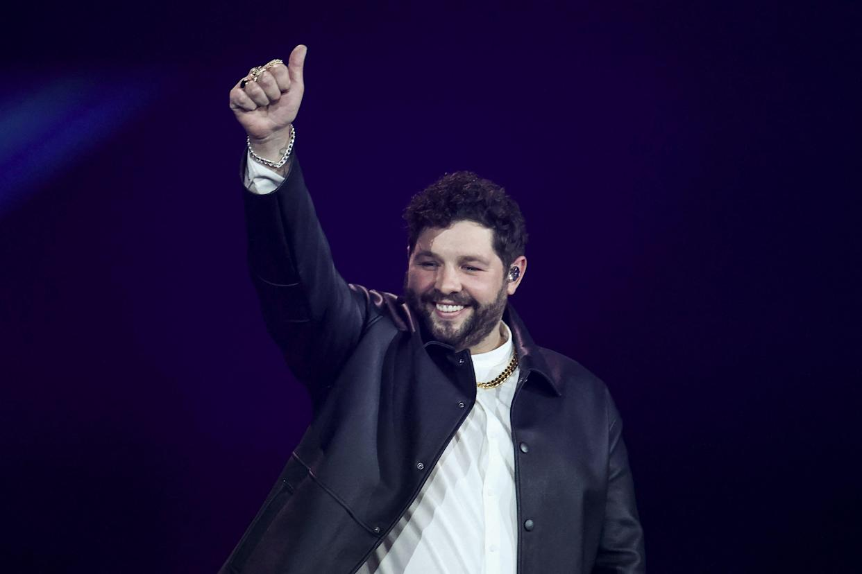 United Kingdom's James Newman appears on stage during the second semi-final of the 65th edition of the Eurovision Song Contest 2021, at the Ahoy convention centre in Rotterdam, on May 20, 2021. (Photo by KENZO TRIBOUILLARD / AFP) (Photo by KENZO TRIBOUILLARD/AFP via Getty Images)