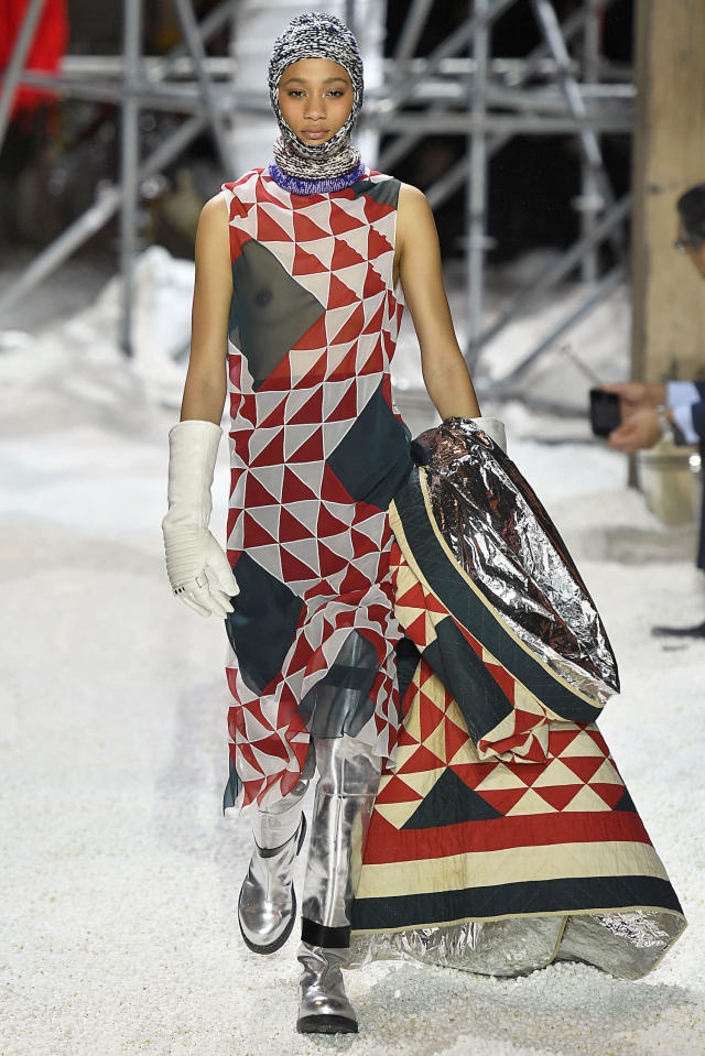 <p>A model wears a balaclava, geometric patterned dress, and matching protective quilt blanket at the Calvin Klein fall 2018 show. (Photo: Getty Images) </p>