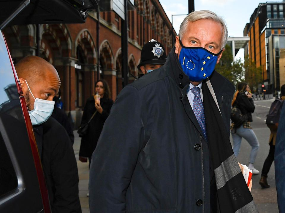EU Chief negotiator Michel Barnier wears a face mask as he arrives at St Pancras station (AP)