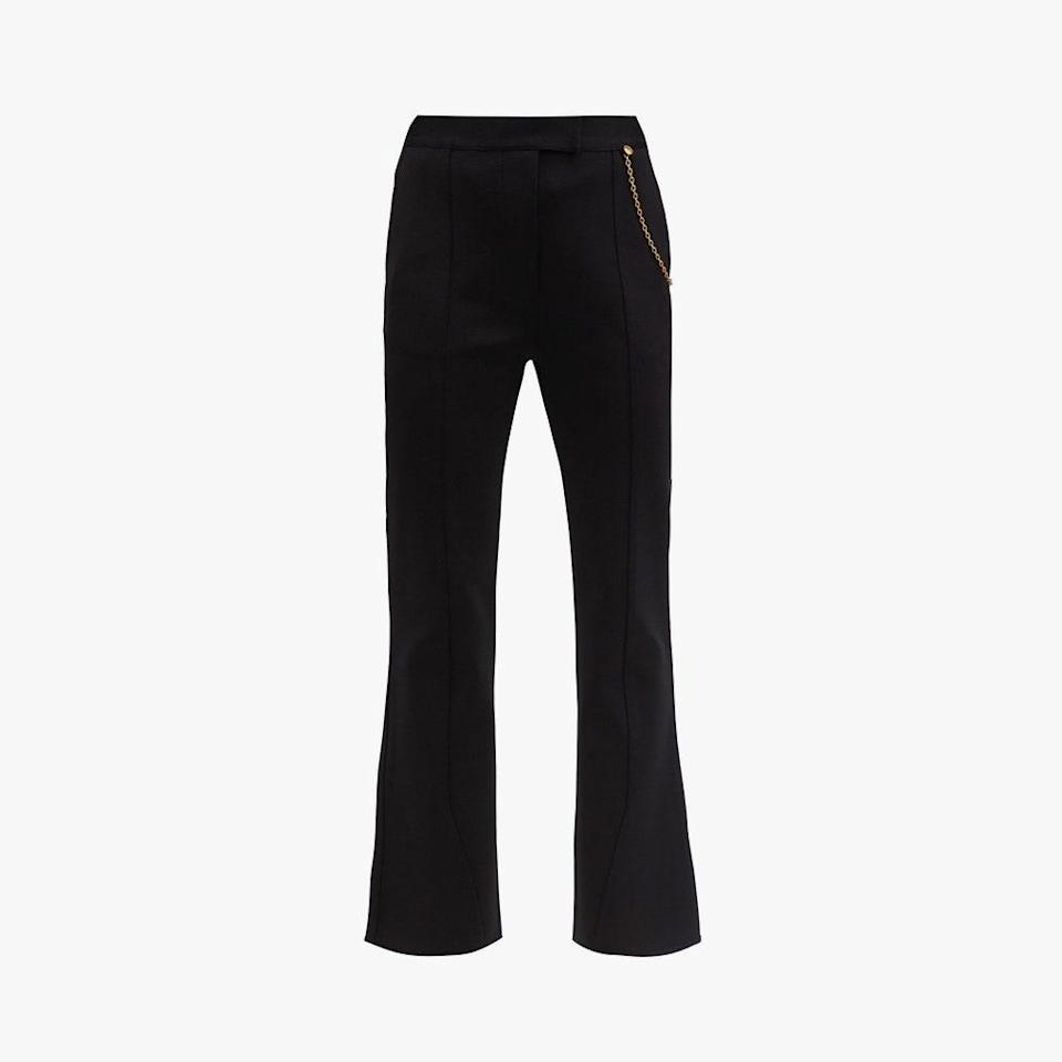 "$1555, MATCHESFASHION.COM. <a href=""https://www.matchesfashion.com/us/products/Givenchy-Chain-embellished-kick-flare-trousers-1359793"" rel=""nofollow noopener"" target=""_blank"" data-ylk=""slk:Get it now!"" class=""link rapid-noclick-resp"">Get it now!</a>"