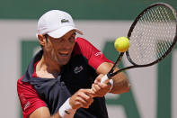 Spain's Pablo Andujar backhands to Austria's Dominic Thiem during their first round match of the French Open tennis tournament at the Roland Garros stadium Sunday, May 30, 2021 in Paris. (AP Photo/Christophe Ena)