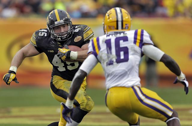 Iowa fullback Mark Weisman (45) cuts in front of LSU defensive back Tre'Davious White (16) during the third quarter of the Outback Bowl NCAA college football game Wednesday, Jan. 1, 2014, in Tampa, Fla. LSU won 21-14. (AP Photo/Chris O'Meara)