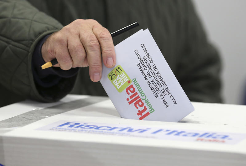 "A man casts his vote during a primary runoff, in Piacenza, Italy, Sunday, Dec. 2, 2012. Italians are choosing a center-left candidate for premier for elections early next year, an important primary runoff given the main party is ahead in the polls against a center-right camp in utter chaos over whether Silvio Berlusconi will run again. Sunday's runoff pits veteran center-left leader Pier Luigi Bersani, 61, against the 37-year-old mayor of Florence, Matteo Renzi, not shown, who has campaigned on an Obama-style ""Let's change Italy now"" mantra. (AP Photo/Antonio Calanni)"