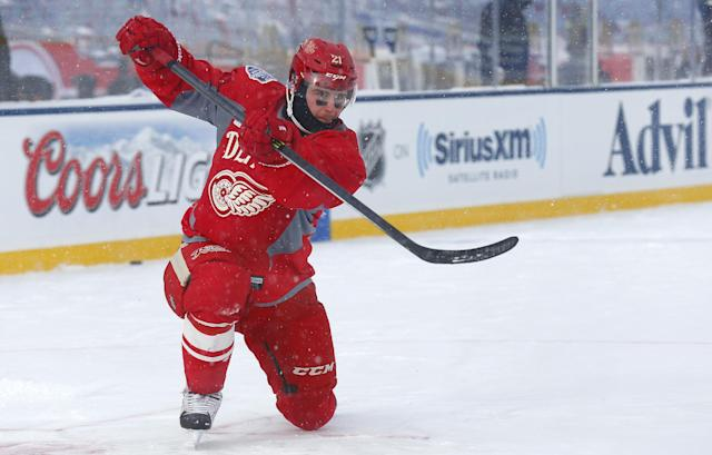Detroit Red Wings forward Tomas Tatar (21), of Slovakia, shoots a puck during practice on the outdoor rink for the NHL Winter Classic hockey game against the Toronto Maple Leafs at Michigan Stadium in Ann Arbor, Mich., Tuesday, Dec. 31, 2013. The game is scheduled for New Year's Day. (AP Photo/Paul Sancya)