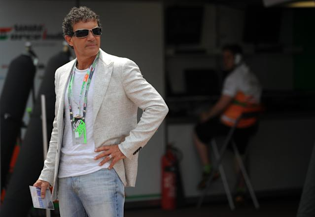 Spanish actor Antonio Banderas stands prior racing at the Circuit de Monaco on May 27, 2012 in Monte Carlo during the Monaco Formula One Grand Prix. AFP PHOTO / DIMITAR DILKOFFDIMITAR DILKOFF/AFP/GettyImages