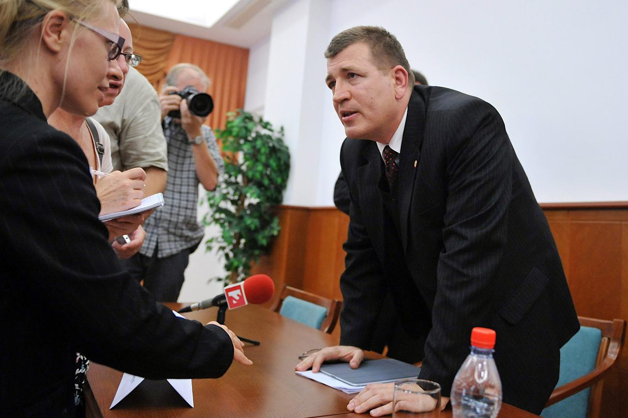 Budapest's acting chief prosecutor Tibor Ibolya, right, speaks to journalists at a news conference concerning the arrest of alleged Nazi war criminal Laszlo Csatary in Budapest, Hungary, Wednesday, July 18, 2012. Hungarian prosecutors said Wednesday they had taken into custody, and charged with war crimes, a man suspected of taking part in the deportation of Jews during the Holocaust. (AP Photo/MTI, Tamas Kovacs)