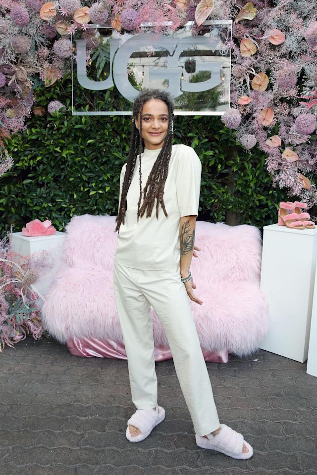 """<p><strong>Who:</strong> Sasha Lane</p><p><strong>Affordable Fashion Find: Ugg</strong> furry slides, $100, <a rel=""""nofollow"""" href=""""https://www.ugg.com/womens-slippers/fluff-yeah-slide/1095119.html"""">ugg.com</a>.</p><p><a rel=""""nofollow"""" href=""""https://www.ugg.com/womens-slippers/fluff-yeah-slide/1095119.html"""">SHOP NOW</a><br></p><p><strong>Why We Love It: </strong>Making for a truly unexpected way to top off any look, Ugg's fluffy slides win at both comfort and playfulness. </p>"""