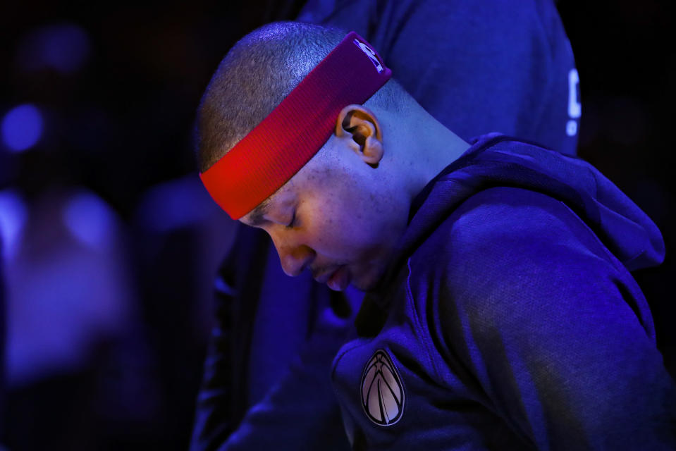 FILE - Washington Wizards guard Isaiah Thomas (4) stands during the National Anthem prior to an NBA basketball game against the Atlanta Hawks in Atlanta, in this Sunday, Jan. 26, 2020, file photo. Two-time NBA All-Star Isaiah Thomas hopes playing this weekend with USA Basketball in FIBA AmeriCup qualifying in Puerto Rico gives an NBA club reason to sign him. (AP Photo/Todd Kirkland, File)