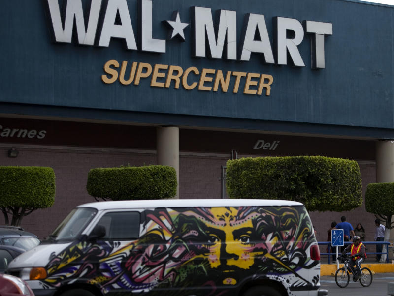 A van covered by a mural sits parked outside a Walt-Mart Super Center in Mexico City, Saturday, April 21, 2012.  Wal-Mart Stores Inc. hushed up a vast bribery campaign that top executives of its Mexican subsidiary carried out to build stores across Mexico, according to a published report by the New York Times. Wal-Mart is Mexico's largest private employer. (AP Photo/Dieu Nalio Chery)