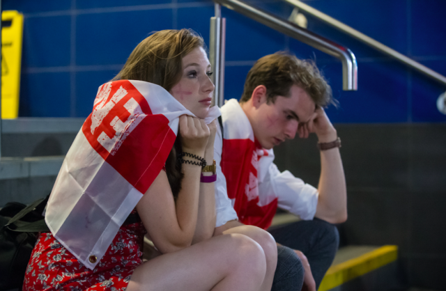 <p>The faces on these fans in Birmingham will be all to familiar to England fans. (SWNS) </p>
