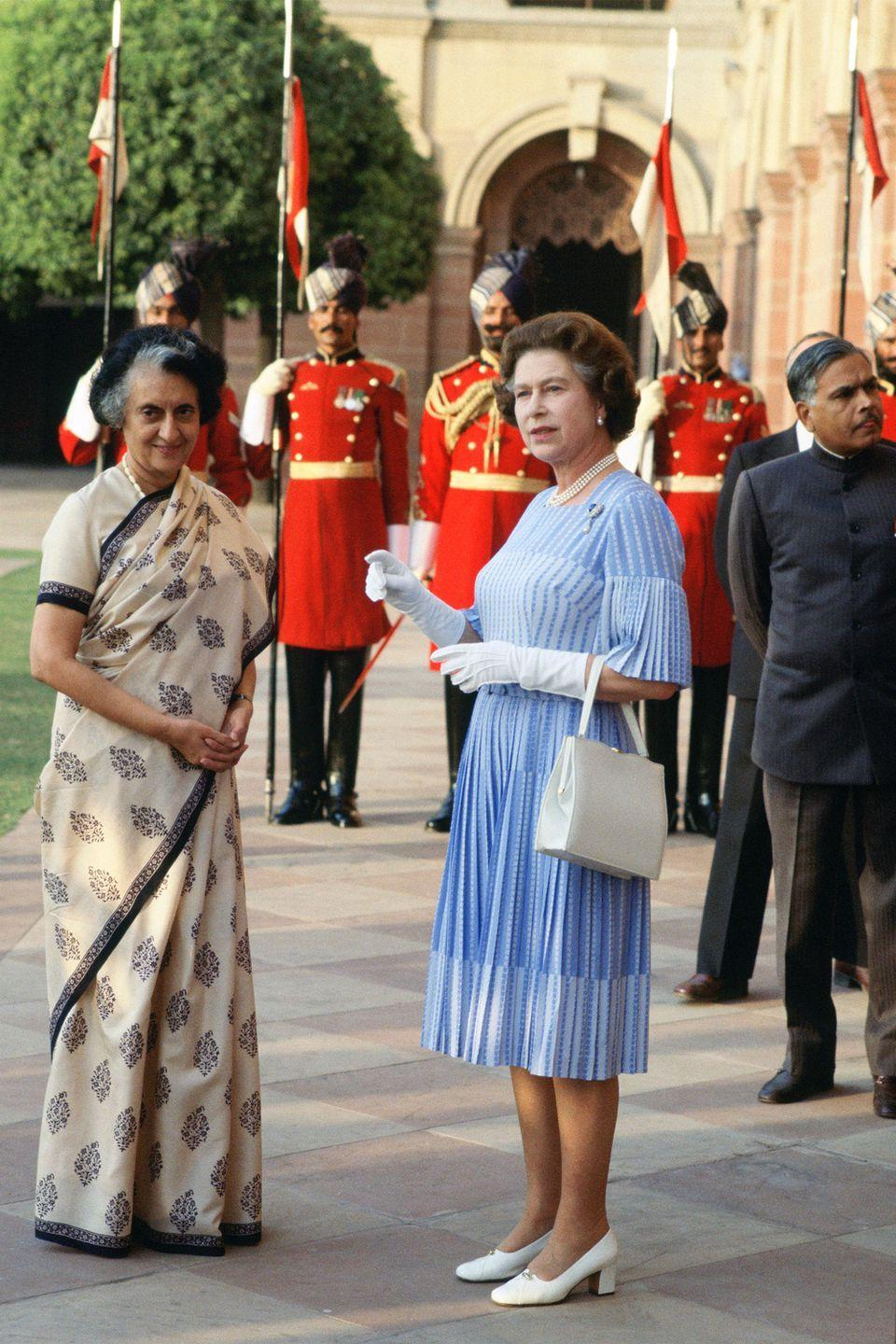 <p>Queen Elizabeth II looked pleased to meet Indira Gandhi, the first female Prime Minister of India during a visit to the country.</p>