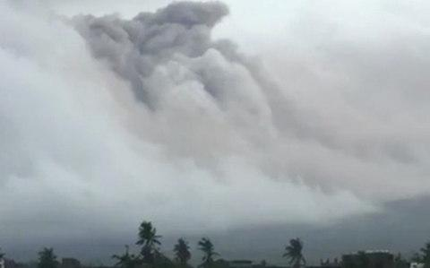 Clouds of ash engulf the volcano in Legazpi - Credit: Reuters