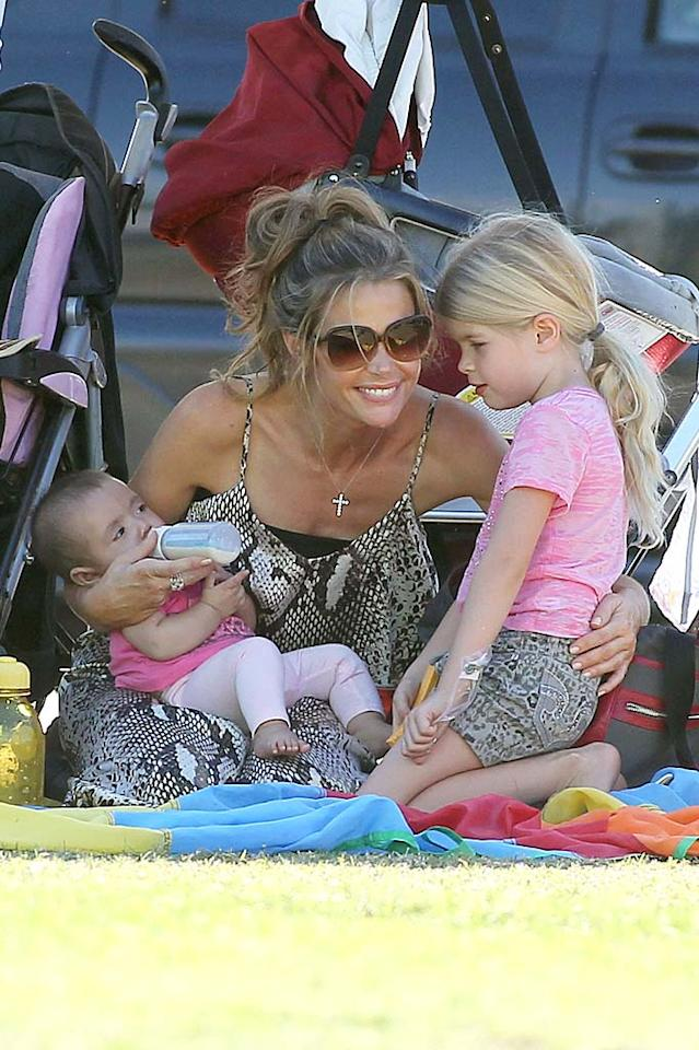 "After the adoption of baby Eloise over the summer, actress Denise Richards' brood comprised a trio of little girls, including big sisters (with ex-huband Charlie Sheen) Sam, 7, and Lola, 6, but it didn't come together easily. ""Some people think if a celebrity wants a baby, they get one the next day,"" Richards revealed to <i>Us Weekly</i>. ""The adoption took two years, and there were times I felt discouraged, times when I got close to adopting a baby and it fell through. But I knew the right baby would find us."" Looks like she did!"