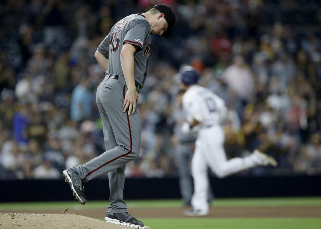 Arizona Diamondbacks starting pitcher Taylor Clarke gathers himself on the mound as San Diego Padres' Hunter Renfroe rounds third after hitting a solo home run during the fifth inning of a baseball game in San Diego, Saturday, Sept. 21, 2019. (AP Photo/Alex Gallardo)