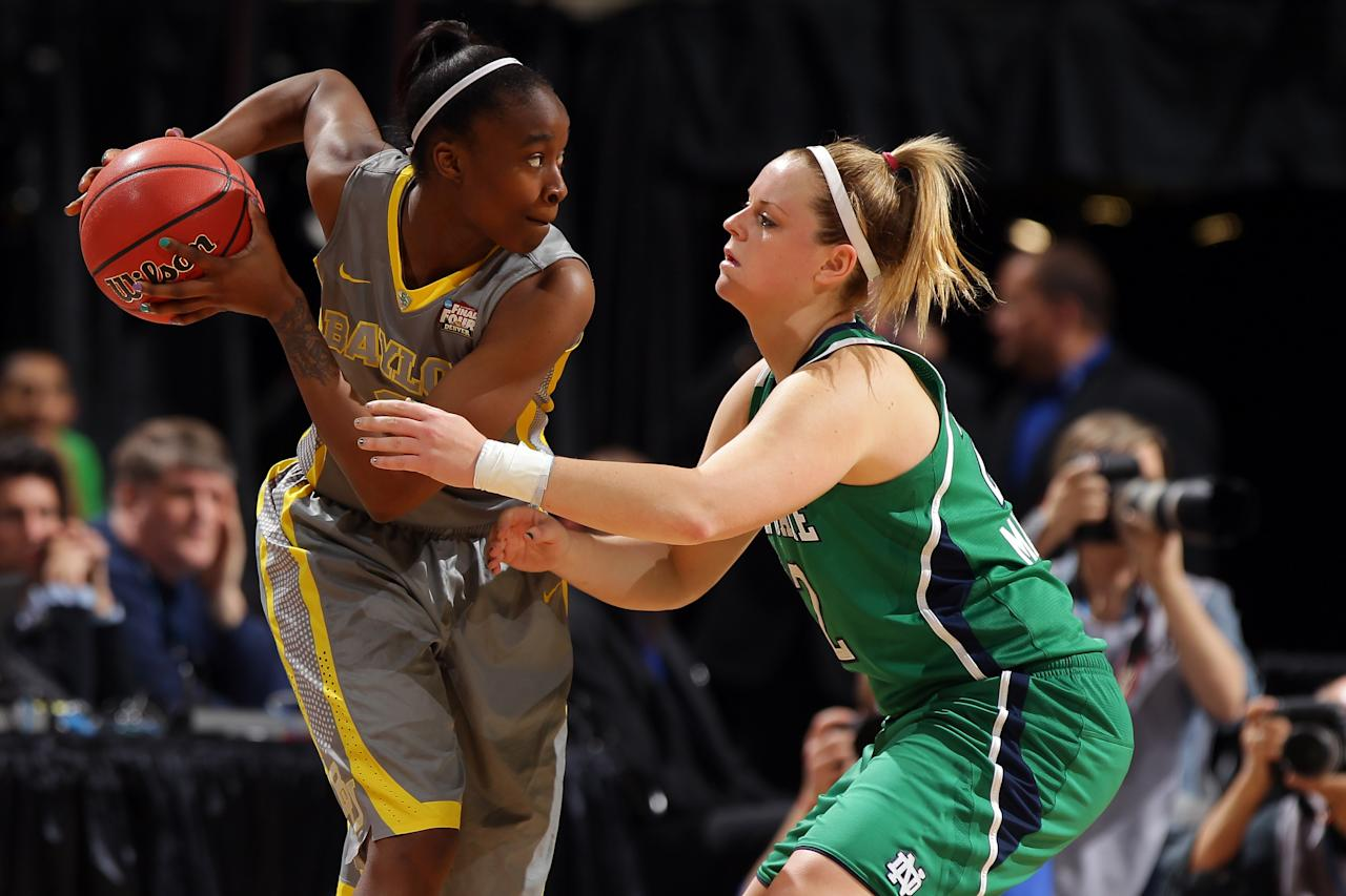 DENVER, CO - APRIL 03:  Jordan Madden #3 of the Baylor Bears looks to pass in the first half against Brittany Mallory #22 of the Notre Dame Fighting Irish during the National Final game of the 2012 NCAA Division I Women's Basketball Championship at Pepsi Center on April 3, 2012 in Denver, Colorado.  (Photo by Doug Pensinger/Getty Images)