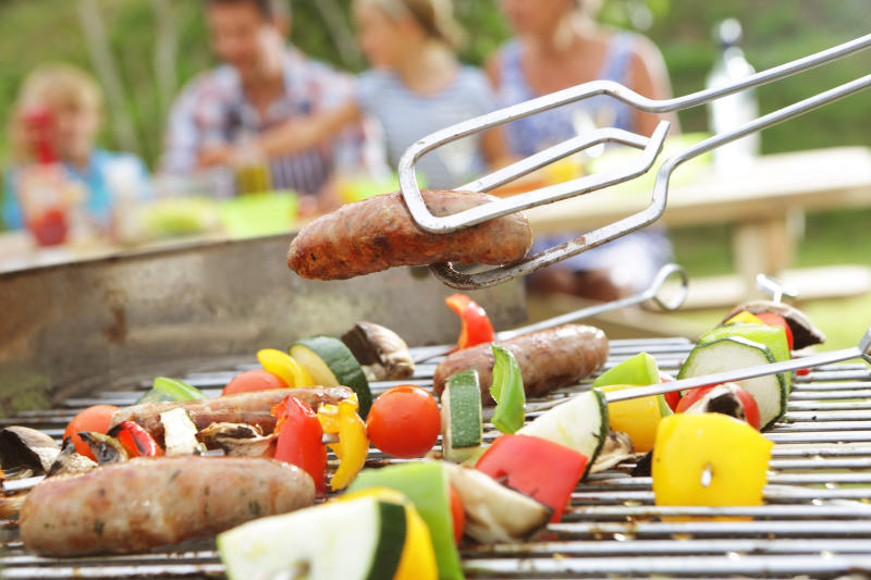 Family having BBQ in garden, close up of food