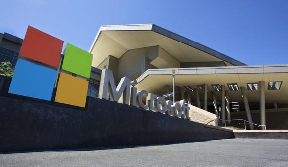 Microsoft's logo in front of one of its buildings.