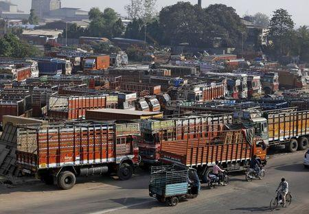 Trucks are seen parked in an open plot near a national highway on the outskirts of Ahmedabad, India, December 2, 2015. REUTERS/Amit Dave