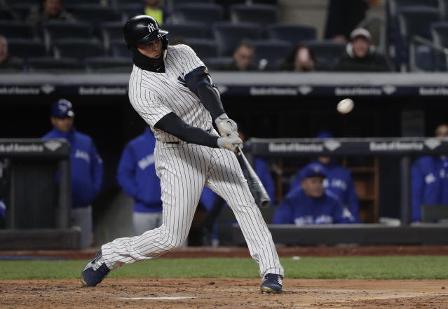 New York Yankees' Giancarlo Stanton connects for a two-run home run against the Toronto Blue Jays during the third inning of a baseball game Friday, April 20, 2018, in New York. (AP Photo/Julie Jacobson)