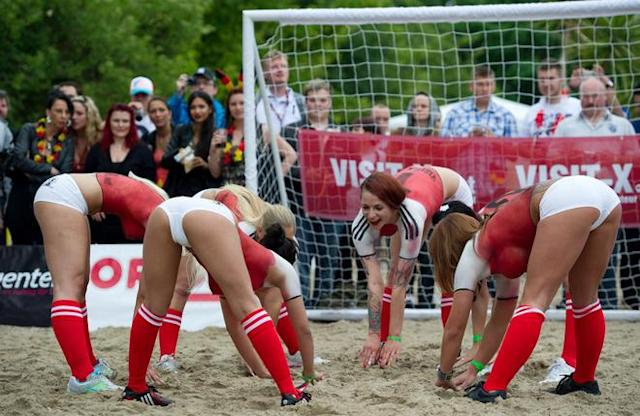 Porn actresses with body paint football jerseys take part in a fun soccer match of Germany vs Denmark on June 16, 2012 in Berlin, one day before the Euro 2012 football championship's match Germany vs Denmark to take place in Lviv, Ukraine. In the fun match, the girls of Denmark won 13-1. AFP PHOTO / JOHANNES EISELEJOHANNES EISELE/AFP/GettyImages