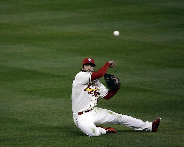 St. Louis Cardinals second baseman Matt Carpenter throws out Boston Red Sox's Daniel Nava from his knees during the second inning of Game 3 of baseball's World Series Saturday, Oct. 26, 2013, in St. Louis. (AP Photo/David J. Phillip)