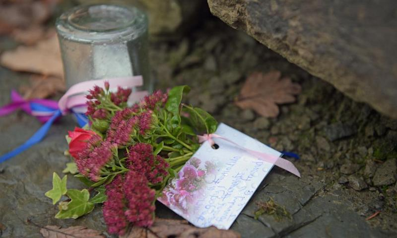 A floral tribute left outside the farmhouse in Llangammarch Wells, Powys.
