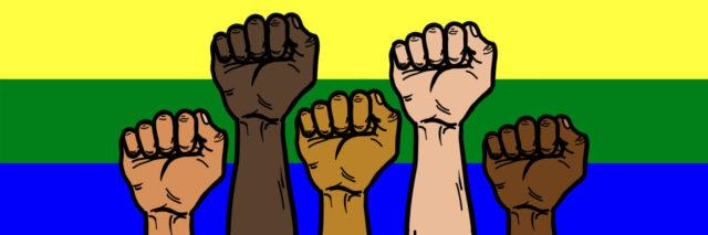 A group of multi-ethnic hands raising up with rainbow flag background.