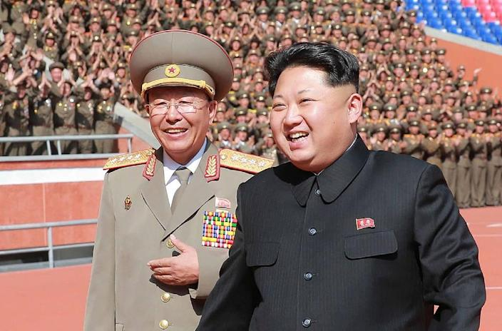 North Korean leader Kim Jong-Un (R) shares a light moment with then the chief of the Korean People's Army General Staff Ri Yong-Gil, in Pyongyang, in October 2015 (AFP Photo/-)