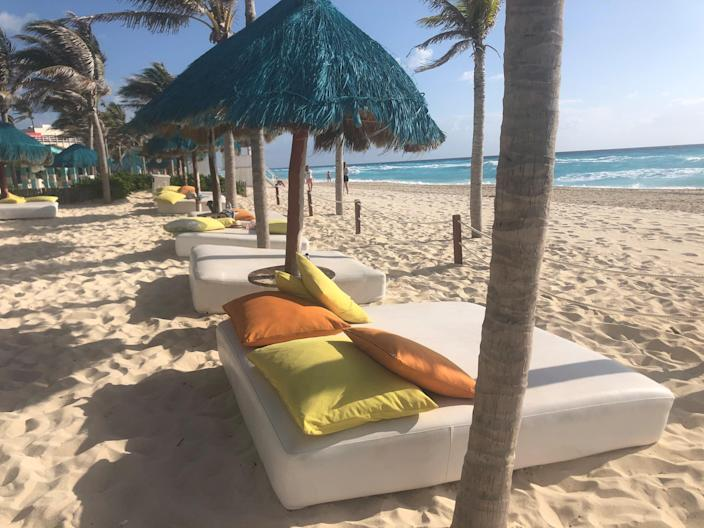 Beachfront day beds are available in Cancun, Mexico.